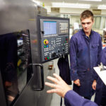 how to get workforce to adopt lean manufacturing, boss with employee at manufacturing system