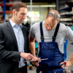 Andon system used in Smart Manufacturing by boss and employee